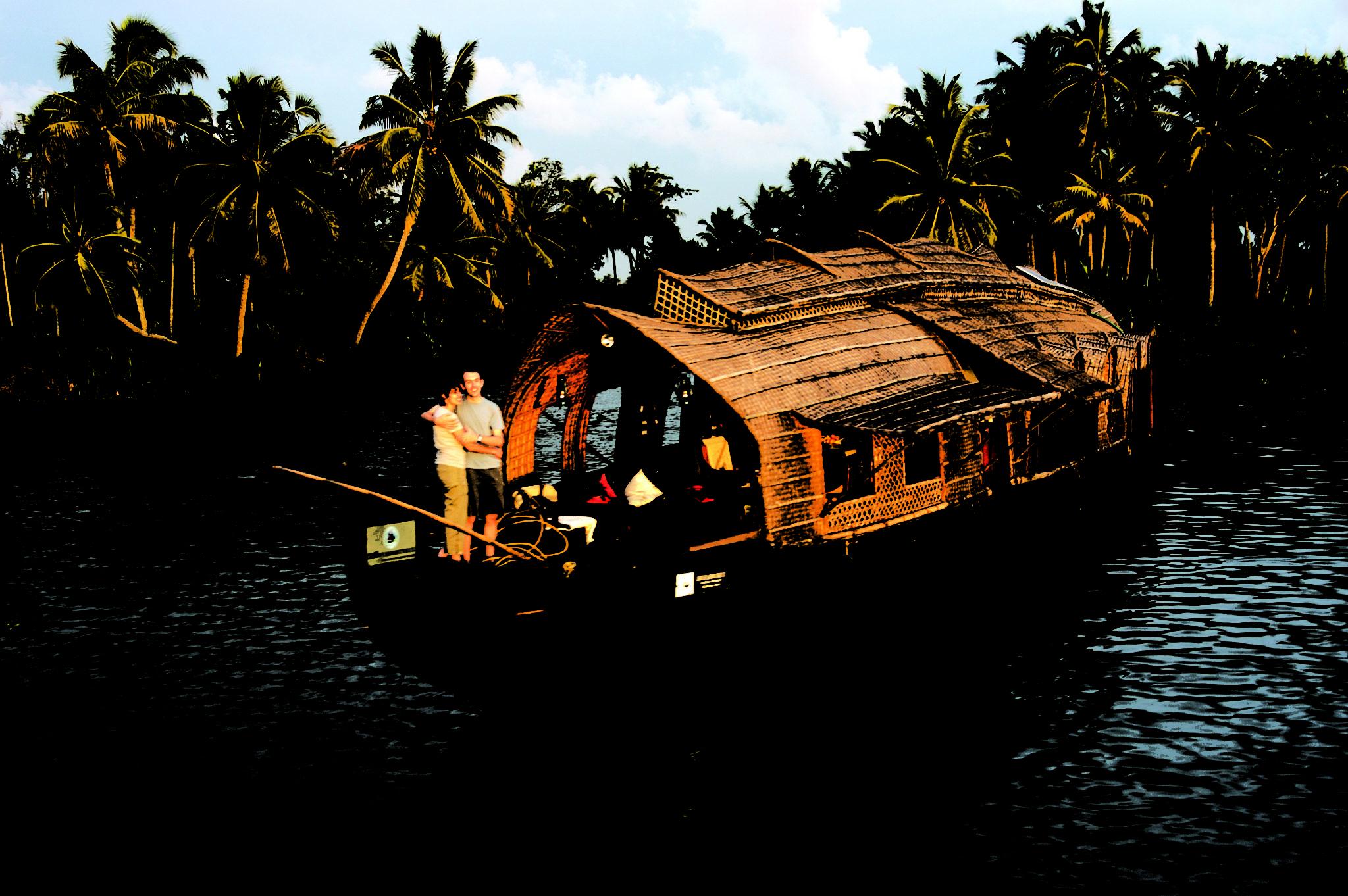 Kerala Tour Package - 2020-2021 - Couple Enjoying Backwater Houseboat
